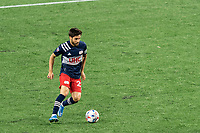FOXBOROUGH, MA - MAY 22: Carles Gil #22 of New England Revolution dribbles during a game between New York Red Bulls and New England Revolution at Gillette Stadium on May 22, 2021 in Foxborough, Massachusetts.
