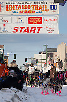 Musher Marshall Newton and Iditarider Marcia Docter.leave the 2011 Iditarod ceremonial start line in downtown Anchorage, Alaska