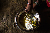 25 year old Sri Kanthi Devi eats her lunch of a rice and lentils in her house in Ramgarwa village in Raxaul district in Bihar, India.