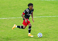 WASHINGTON, DC - NOVEMBER 8: Moses Nyeman #27 of D.C. United dribbles during a game between Montreal Impact and D.C. United at Audi Field on November 8, 2020 in Washington, DC.