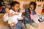 Preschool New York City horizontal 4-5 year olds pretend area two girls talking on the telephone one using a cucumber and the other a plastic phone