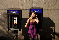 Montreal (Qc) Canada - august 13 2009 - model release photo - A vietnamese girl using a BELL pay phone