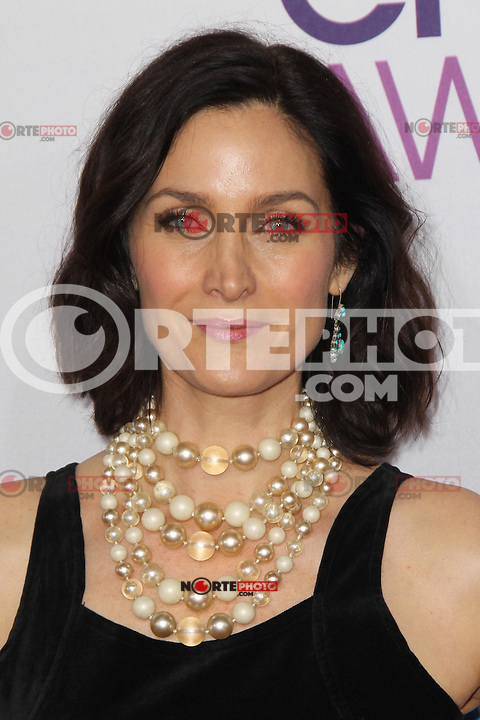 LOS ANGELES, CA - JANUARY 09: Carrie Anne Moss at the 39th Annual People's Choice Awards at Nokia Theatre L.A. Live on January 9, 2013 in Los Angeles, California. Credit: mpi21/MediaPunch Inc. /NORTEPHOTO