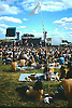 Reading Blues & Jazz Festival, Reading, Berkshire in 1974 before the Corporations moved in. Shot from the arena showing the audience and flags flying and space to spare.<br /> <br /> Stock Photo by Paddy Bergin
