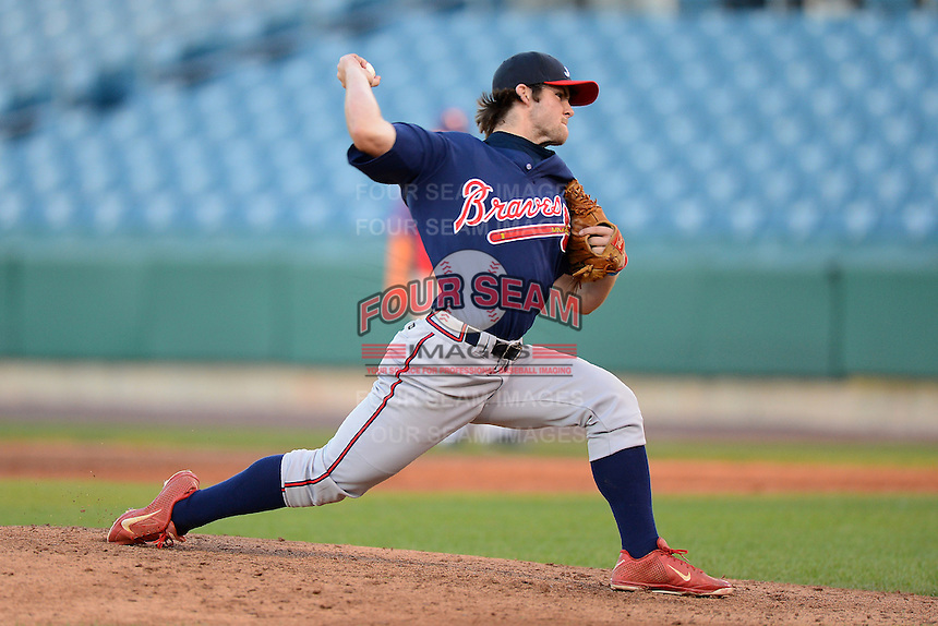 Michael Gettys (11) of Gainesville High School in Gainesville, Florida playing for the Atlanta Braves scout team during the East Coast Pro Showcase on August 1, 2013 at NBT Bank Stadium in Syracuse, New York.  (Mike Janes/Four Seam Images)