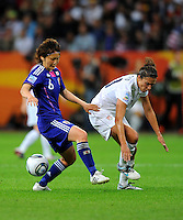 Carli Lloyd (r) of team USA and Mizuho Sakaguchi of Japan during the FIFA Women's World Cup Final USA against Japan at the FIFA Stadium in Frankfurt, Germany on July 17th, 2011.