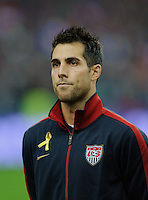 Carlos Bocanegra of team USA stands for the national anthem prior to the friendly match France against USA at the Stade de France in Paris, France on November 11th, 2011.