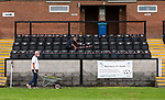 Pictured: Volunteer groundsman Peter Robinson and maintenance volunteer John Harper tape off seating during preparations ahead of phase two of crowds being welcomed back into sporting events at The Raymond McEnhill Stadium in Salisbury, Wilts.<br /> <br /> Inline with the governments easing of lockdown restrictions, Salisbury Football Club are preparing to welcome back 30% of their fans as of this Monday, August 31st which will be around 600. <br /> <br /> Salisbury FC play in Southern League Premier Division South, or step 3 of the non-league football ladder. <br /> <br /> © Jordan Pettitt/Solent News & Photo Agency<br /> UK +44 (0) 2380 458800