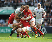 Joe Launchbury of England is tackled by James King, Gethin Jenkins and Rhys Webb of Wales during the Old Mutual Wealth Cup match between England and Wales at Twickenham Stadium on Sunday 29th May 2016 (Photo: Rob Munro/Stewart Communications)