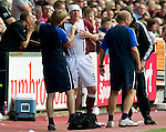 Hearts v St Johnstone...14.08.10  .Kevin Kyle is patched up after a clash of heads with Murray Davidson.Picture by Graeme Hart..Copyright Perthshire Picture Agency.Tel: 01738 623350  Mobile: 07990 594431