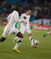 The USA's  Landon Donovan prepares to pass the ball to Jozy Altidore.  USA played Algeria in a 2010 FIFA World Cup first round match at Loftus Versfeld Stadium in Tshwane/Pretoria, South Africa on Wednesday, June 23, 2010. The USA defeated Algeria 1-0 to win Group C and advance to the second round of the 2010 FIFA World Cup.