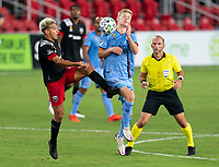 WASHINGTON, DC - SEPTEMBER 06: Yamil Asad #11 of D.C. United fights for the ball with Keaton Parks #55 of New York City FC during a game between New York City FC and D.C. United at Audi Field on September 06, 2020 in Washington, DC.