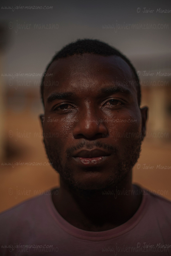 """AGADEZ, NIGER — <br /> <br /> 23-year-old Mpoma Bedding Chovis is a native of Cameroon. He worked as a construction worker in his native country but dreams of becoming a professional soccer player. He tried out for division one in Cameroon but said that he was cheated on several occasions by would-be soccer recruiters. """"My only dream is to become a professional footballer."""" <br /> The convoy he was riding in through the Sahara desert ran into a police check-point outside the city of Arlit in north Niger. He and 8 other migrants from Cameroon were  robbed of all their money by the police. He is now hoping to find someone to help him return to Cameroon."""
