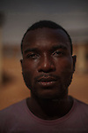 "AGADEZ, NIGER — <br /> <br /> 23-year-old Mpoma Bedding Chovis is a native of Cameroon. He worked as a construction worker in his native country but dreams of becoming a professional soccer player. He tried out for division one in Cameroon but said that he was cheated on several occasions by would-be soccer recruiters. ""My only dream is to become a professional footballer."" <br /> The convoy he was riding in through the Sahara desert ran into a police check-point outside the city of Arlit in north Niger. He and 8 other migrants from Cameroon were  robbed of all their money by the police. He is now hoping to find someone to help him return to Cameroon."