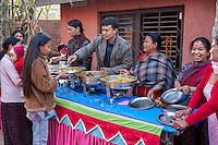 Nepal, Kathmandu.  Members of a Neighborhood Hindu temple Serve a Buffet Lunch.