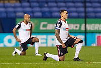 Bolton Wanderers' Antoni Sarcevic 'takes the knee' in support of the Black Lives Matter movement<br /> <br /> Photographer Andrew Kearns/CameraSport<br /> <br /> The EFL Sky Bet League Two - Bolton Wanderers v Mansfield Town - Tuesday 3rd November 2020 - University of Bolton Stadium - Bolton<br /> <br /> World Copyright © 2020 CameraSport. All rights reserved. 43 Linden Ave. Countesthorpe. Leicester. England. LE8 5PG - Tel: +44 (0) 116 277 4147 - admin@camerasport.com - www.camerasport.com