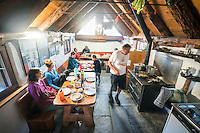 The Via Alta Verzasca is a five day ridge traverse hike above the Valle Verzasca in the Ticino region of Switzerland. Picking blueberries along the route. Eating dinner inside the Capanna Efra.