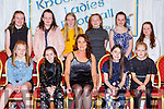 Catherine Ring Chairperson with footballers at the Knocknagree ladies GAA social in the Killarney Avenue Hotel on Saturday night front row l-r: Aine Fitzpatrick, Rhea Fitzgerald, Elaina Brosnan and Lucy Courtney. Back row: Emma Daly, Ritz Fitzpatrick, Kate Murphy, Eadaoin McSweeney, Jessica Guerin and Maire Fitzpatrick