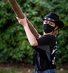 BEACON FALLS, CT-112020JS11—Lauren Mulinski, one of the captains of Woodland Timber Team, compete in the pole toss during the Battle Royal Friday at Woodland Regional High School.<br />  Jim Shannon Republican-American