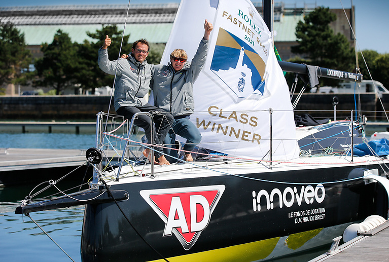 Waving the Class winner flag - AD Fichou - Innovéo Bihannic celebrates winning Figaro 3 Photo: Paul Wyeth