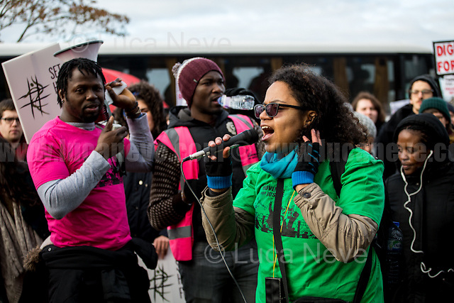 """Antonia Bright (Member of Movement for Justice UK).  <br /> <br /> Bedford (Bedfordshire, England), 03/12/2016. Today, more than two thousand activists and members of the public from across the UK gathered outside the notorious Yarl's Wood I.R.C. Immigration Removal Centre in Bedfordshire, lead by the """"Movement for Justice By Any Means Necessary"""" to protest against the alleged inhuman conditions of the detainees (showed in a recent Channel 4 undercover investigation - http://bit.ly/1E6X4pz) and to call for its immediate closure. <<Yarl's Wood Immigration Removal Centre is a detention centre for foreign nationals prior to their deportation from the United Kingdom, one of 13 such centres currently in the UK. It is located near Milton Ernest in Bedfordshire, England, and is operated by Serco (British outsourcing company based in Hook, Hampshire. It operates public and private transport and traffic control, aviation, military weapons, detention centres, prisons and schools on behalf of its customers - Source Wikipedia.org), who describes the place as """"a fully contained residential centre housing adult women and adult family groups awaiting immigration clearance."""" Its population is, and has been, overwhelmingly female. […] >> (Source - Wikipedia.org at http://bit.ly/1GiTFWB). The protest of today was the 10th demo organised at Yarl's Wood I.R.C. and the largest ever at a detention centre in the UK.<br /> <br /> For more information please click here: https://www.facebook.com/events/1774538206143537/ & http://www.movementforjustice.org/"""