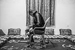 Tarek prays in his living room. For several months, Tarek suffered from ghost limb syndrome (sensation that an amputated or missing limb is still connected to the body and interacts well with other body parts, October 31, 2019<br /> <br /> GAZA, Beit Laya: Tarek prie dans son salon. Pendant plusieurs mois, Tarek a souffert du syndrome du membre fantôme (sensation qu'un membre amputé ou manquant est toujours relié au corps et interagit bien avec d'autres parties du corps,le 31 octobre 2019.
