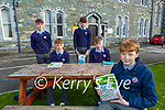 Cian Myers with seated l-r:James Williams and Jack Cronin and back l-r: Evan O'Neill and Calum O'Leary  who returned to studying in St Brendans College Killarney on Monday