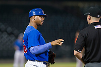 AZL Cubs manager assistant hitting coach Leonel Perez (66) talks to first base umpire Pete Talkington during a game against the AZL Giants on September 6, 2017 at Sloan Park in Mesa, Arizona. AZL Giants defeated the AZL Cubs 6-5 to even up the Arizona League Championship Series at one game a piece. (Zachary Lucy/Four Seam Images)