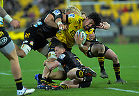 Ardie Savea is tackled during the Super Rugby Aotearoa match between the Hurricanes and Chiefs at Sky Stadium in Wellington, New Zealand on Saturday, 8 August 2020. Photo: Dave Lintott / lintottphoto.co.nz