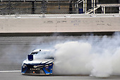 Monster Energy NASCAR Cup Series<br /> Go Bowling 400<br /> Kansas Speedway, Kansas City, KS USA<br /> Saturday 13 May 2017<br /> Martin Truex Jr, Furniture Row Racing, Auto-Owners Insurance Toyota Camry celebrates his win with a burnout<br /> World Copyright: Nigel Kinrade<br /> LAT Images<br /> ref: Digital Image 17KAN1nk10319