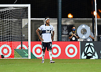 LAKE BUENA VISTA, FL - JULY 26: A dejected Derek Cornelius of Vancouver Whitecaps FC walks back to midfield after his shootout attempt was saved by the goalkeeper during a game between Vancouver Whitecaps and Sporting Kansas City at ESPN Wide World of Sports on July 26, 2020 in Lake Buena Vista, Florida.