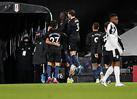 13th March 2021, Craven Cottage, London, England;  Manchester Citys players celebrate the goal by Manchester Citys John Stones for 0-1 in the 47th minute during the English Premier League match between Fulham and Manchester City at Craven Cottage in London