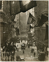 No Known Restrictions: WWI: Germany Surrenders by W.L. Drummond, 1918 (LOC) : celebrations on Wall Street with confetti, American flags, and crowds of people.