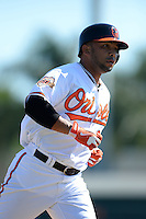 Baltimore Orioles infielder Alex Gonzalez (36) runs the bases after hitting a home run during a spring training game against the Boston Red Sox on March 8, 2014 at Ed Smith Stadium in Sarasota, Florida.  Baltimore defeated Boston 7-3.  (Mike Janes/Four Seam Images)