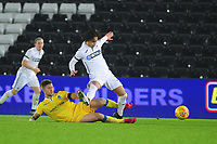Yan Dhanda of Swansea City U21 is tackled by James Clarke of Bristol Rovers during the Checkatrade Trophy match between Swansea City U21 and Bristol Rovers at the Liberty Stadium in Swansea, Wales, UK. Wednesday 05 December 2018
