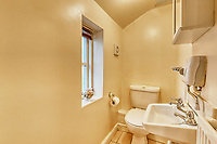 BNPS.co.uk (01202 558833)<br /> Pic: PropertyPublicity/BNPS<br /> <br /> Pictured: The toilet<br /> <br /> Loco-cation, loco-cation, loco-cation..<br /> <br /> This quirky property that is up for sale is all about its loco-cation - as it sits on a railway crossing right next to the train tracks.<br /> <br /> The Grade II listed cottage was built in 1850 to house the gatekeeper whose job it was to close the gates at the road crossing whenever a train was due.<br /> <br /> The gates, in the village of Stone, Staffs, were automated many years ago.