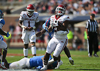 Arkansas running back Dominique Johnson (20) carries the ball, Saturday, October 9, 2021 during the second quarter of a football game at Vaught Hemingway Stadium in Oxford, Miss. Check out nwaonline.com/211010Daily/ for today's photo gallery. <br /> (NWA Democrat-Gazette/Charlie Kaijo)