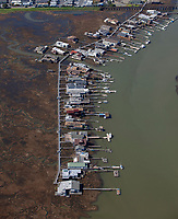 aerial photograph waterfront homes and piers at Corte Madera Creek accessible via the Greenbay Boardwalk One shown on the left side of the photograph, Larkspur, Marin County, California