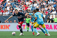 FOXBOROUGH, MA - AUGUST 8: Tommy McNamara #26 of New England Revolution dribbles  as Jack McGlynn #16 of Philadelphia Union defends during a game between Philadelphia Union and New England Revolution at Gillette Stadium on August 8, 2021 in Foxborough, Massachusetts.