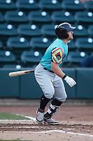 Blaine Crim (9) of the Llamas de Hickory follows through on a home run against the Winston-Salem Rayados at Truist Stadium on July 6, 2021 in Winston-Salem, North Carolina. (Brian Westerholt/Four Seam Images)