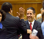 HARTFORD, CT- 03 JANUARY 07- 010307JT17-<br /> State Rep. David Aldarondo, D-75th District, high-fives State Rep. Larry Butler, D-72nd District, on the opening day of the General Assembly's 2007 session at the Capitol in Hartford.<br /> Josalee Thrift Republican-American