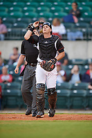Arkansas Travelers catcher Marcus Littlewood in front of home plate umpire Sean Allen during a game against the Midland RockHounds on May 25, 2017 at Dickey-Stephens Park in Little Rock, Arkansas.  Midland defeated Arkansas 8-1.  (Mike Janes/Four Seam Images)