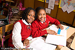 K-8 Parochial School Bronx New York Grade 3 mathematics lesson on measurement using rulers portrait of two girls posing horizontal