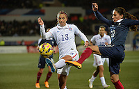 Lorient, France. - Sunday, February 8, 2015:  Alex Morgan (13) of the USWNT and Amel Majri (22) of France. France defeated the USWNT 2-0 during an international friendly at the Stade du Moustoir.