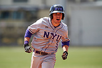 New York University Violets left fielder Adrian Spitz (5) celebrates while running the bases after a home run during a game against the Edgewood Eagles on March 14, 2017 at Terry Park in Fort Myers, Florida.  NYU defeated Edgewood 12-7.  (Mike Janes/Four Seam Images)