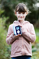 Pictured: Elly Neville with the The British Citizen Award for the Good of the Country at her home in Pembroke, west Wales, UK. Tuesday 20 February 2018<br /> Re: Seven-year-old Elly Neville who was born despite doctors saying her parents would not be able to have any more children, has raised over £150,000 for the cancer ward that treated her father.<br /> Her parents Lyn and Ann had been told they were unlikely to have more children after he underwent a bone marrow transplant in 2005. <br /> Mr Neville subsequently spent a lot of time on the Ward 10 cancer facility at Withybush Hospital in Haverfordwest, Pembrokeshire.<br /> But four years later they were stunned when his painter and decorator wife Ann fell pregnant again.