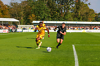 9th October 2021;  VBS Community Stadium, Sutton, London; EFL League 2 football, Sutton United versus Port Vale; David Ajiboye (7) of Sutton United being chased down by James Gibbons (2) of Port Vale.