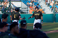 San Jose Giants first baseman Gio Brusa (17) is congratulated by Logan Baldwin (1) after hitting his first home run of the season during a California League game against the Visalia Rawhide on April 13, 2019 at San Jose Municipal Stadium in San Jose, California. Visalia defeated San Jose 4-2. (Zachary Lucy/Four Seam Images)
