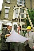 Camden Council staff survey an unsafe empty residential property.