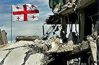 Gori/Georgia  9-2008.<br /> Bandiera della Georgia tra le macerie di una caserma dell'esercito georgiano colpita dall'aviazione russa.<br /> Flag of Georgia among the ruins of a Georgian army barracks hit the Russian aviation.<br /> Photo Livio Senigalliesi